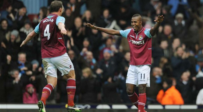 Kevin Nolan celebrates with Modibo Maiga