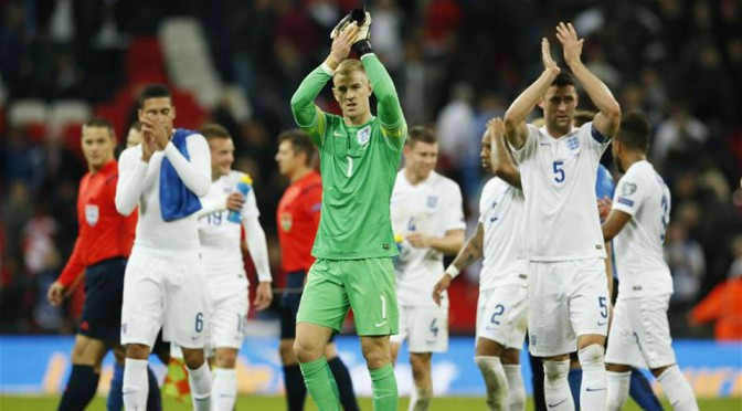 England players celebrate after beating Estonia