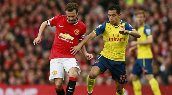 Manchester United's Juan Mata and Arsenal's Alexis Sanchez battle for the ball