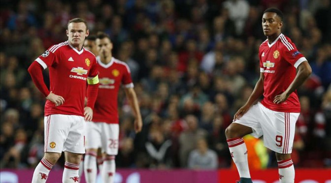 New Manchester United striker Anthony Martial waits to kick off a game with Wayne Rooney