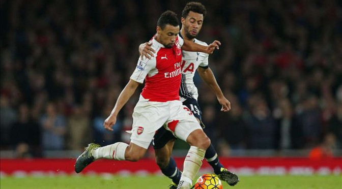 Arsenal's Francis Coquelin is challenged by Dembele of Tottenham