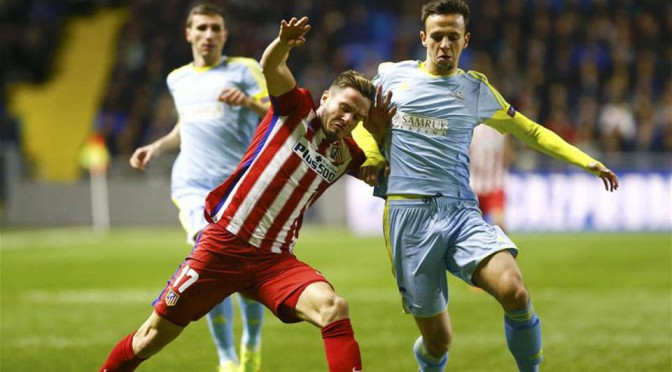 Astana players hold off an Atletico Madrid attack