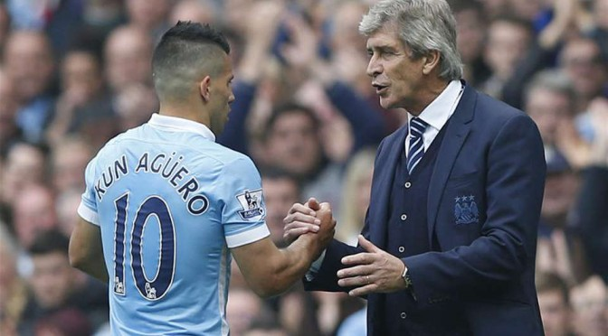 Manchester City's Sergio Aguero with manager Manuel Pelligrini