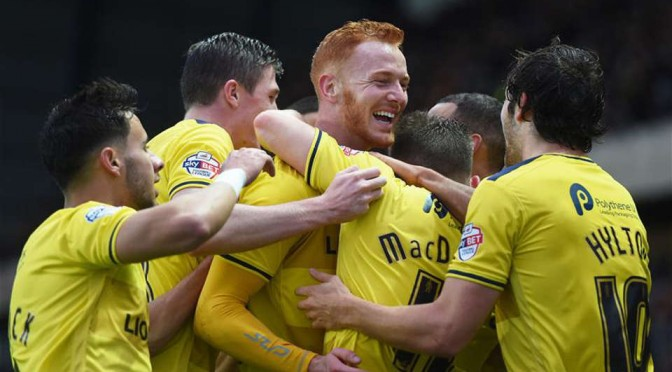 Oxford United players celebrate scoring