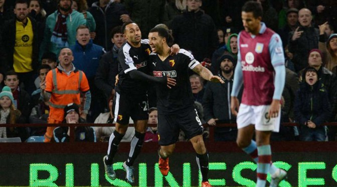Troy Deeney celebrates scoring against Aston Villa