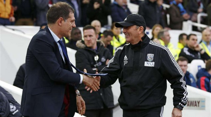 Managers Slaven Bilic and Tony Pulis shake hands
