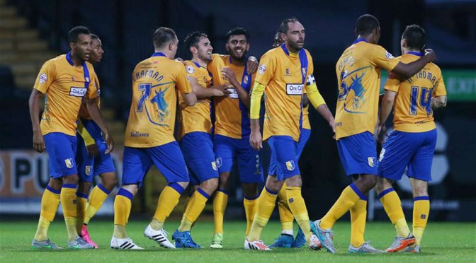 Mansfield Town players celebrate a goal