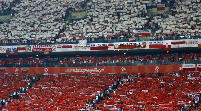 Polish fans display their national flag