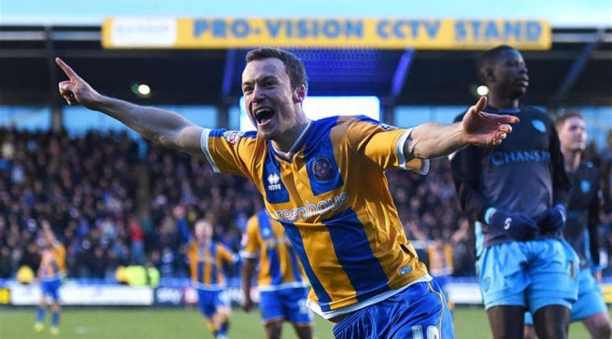 Shrewsbury Town's Shaun Whalley celebrates scoring against Sheffield Wednesday in the FA Cup