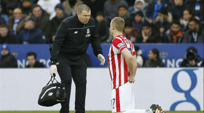 Stoke City skipper Ryan Shawcross receives treatment