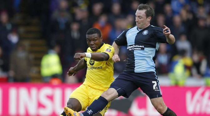 Wycombe Wanderers top score Garry Thompson battles Jores Okore in the FA Cup